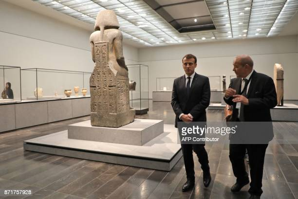 French President Emmanuel Macron and French Foreign Minister JeanYves Le Drian visit the Louvre Abu Dhabi Museum on November 8 2017 during its...