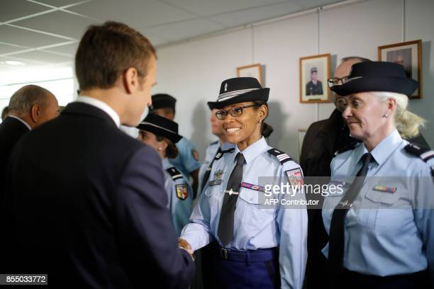 French President Emmanuel Macron and French Interior minister Gerard Collomb meet with police officers during a visit to Gendarmerie barracks in...