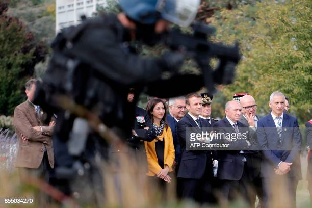 French President Emmanuel Macron and French Interior Minister Gerard Collomb watch a police demonstration during a visit to Gendarmerie barracks in...