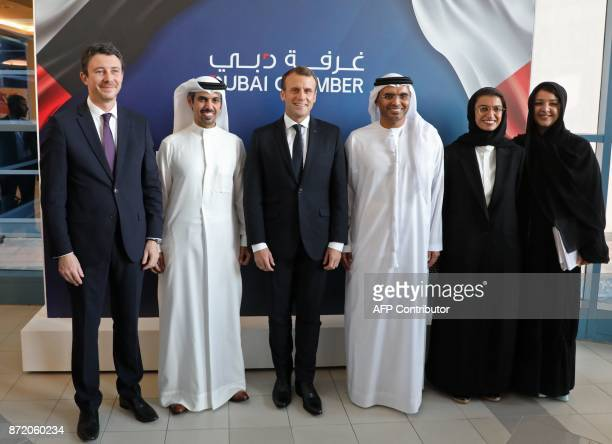 French President Emmanuel Macron and French Junior Economy Minister Benjamin Griveaux pose for a picture with Majid Saif Al Ghurair chairman of the...