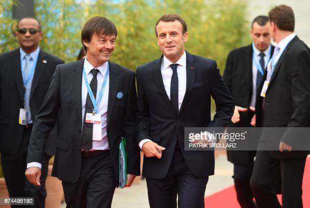 French President Emmanuel Macron and French Minister for the Ecological and Inclusive Transition Nicolas Hulot arrive to attend the UN conference on...