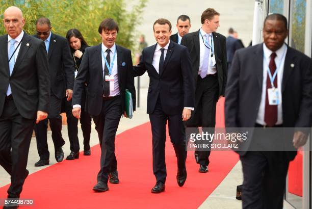 TOPSHOT French President Emmanuel Macron and French Minister for the Ecological and Inclusive Transition Nicolas Hulot arrive to attend the UN...