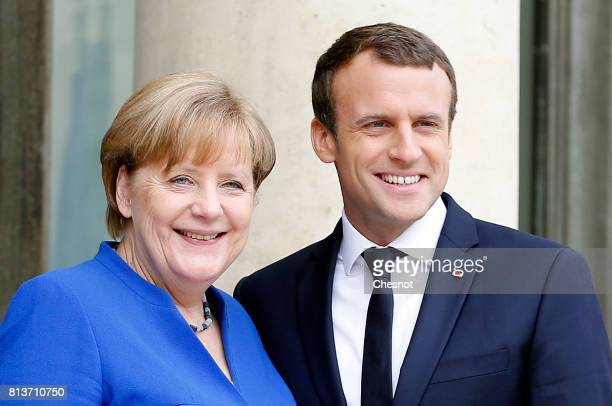 French President Emmanuel Macron and German Chancellor Angela Merkel appear on the door steps of the Elysee Presidential Palace on July 13 2017 in...
