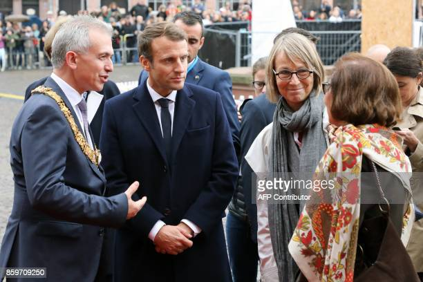 French President Emmanuel Macron and his Culture Minister Francoise Nyssen are welcomed by the mayor Peter Feldmann before a welcoming ceremony at...