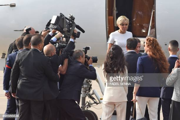 French President Emmanuel Macron and his wife Brigitte are welcomed by Moroccan King Mohammed VI and his wife Princess Lalla Salma upon their arrival...