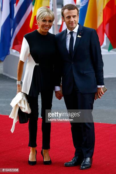 French President Emmanuel Macron and his wife Brigitte Macron arrive to attend a concert at the Elbphilharmonie philharmonic concert hall on the...