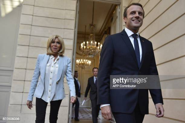 French President Emmanuel Macron and his wife Brigitte Macron arrive to attend a concert by the Pierre Claver Association at the Elysee Palace in...