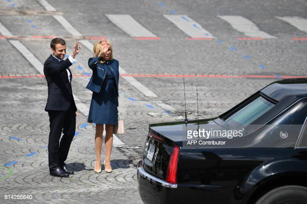 French President Emmanuel Macron and his wife Brigitte Macron bid farewell to US president leaving by car at the end of the annual Bastille Day...