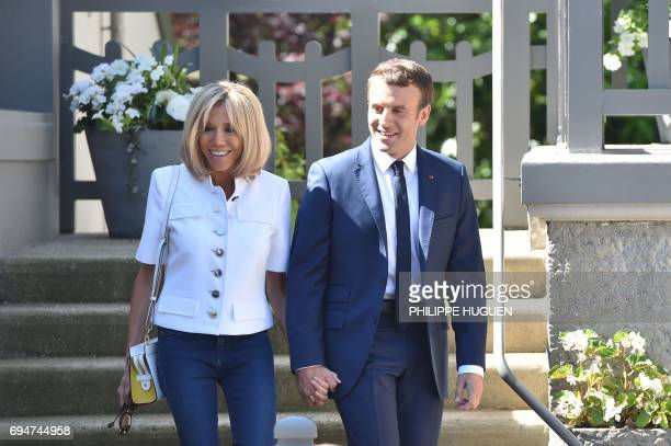 French President Emmanuel Macron and his wife Brigitte Macron leave their home in Le Touquet northern France on June 11 during the first round of...