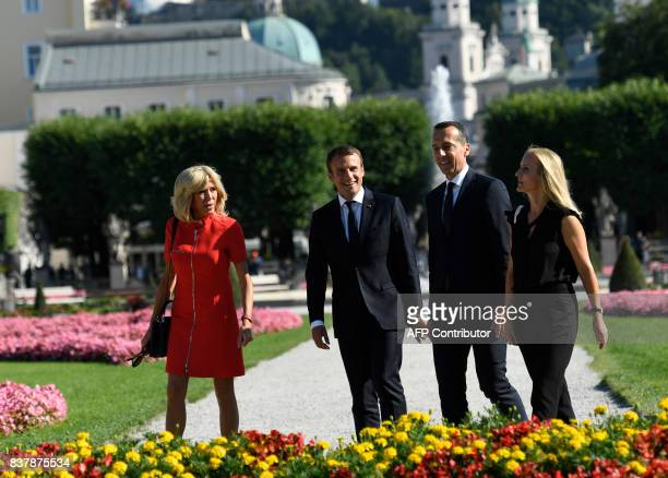 French President Emmanuel Macron and his wife Brigitte Macron leave after a group photo with Austrian chancellor Christian Kern and his wife Eveline...
