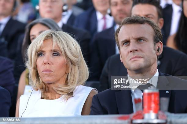 French President Emmanuel Macron and his wife Brigitte Macron listen to the speech of the Greek Prime Minister on the Pnyx hill in Athens on...