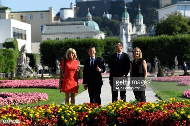 TOPSHOT French President Emmanuel Macron and his wife Brigitte Macron pose for a group photo with Austrian chancellor Christian Kern and his wife...