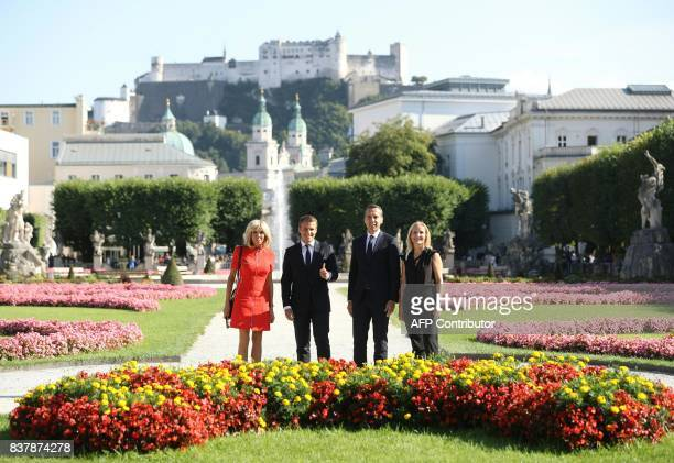 French President Emmanuel Macron and his wife Brigitte Macron pose for a group photo with Austrian chancellor Christian Kern and his wife Eveline...