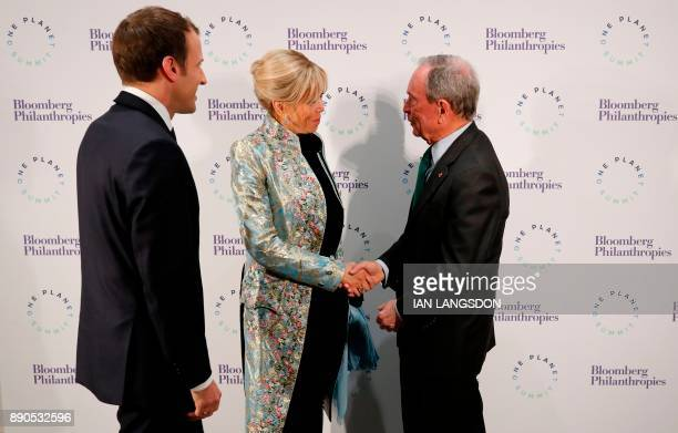 French President Emmanuel Macron and his wife Brigitte Macron speak with former New York mayor and United Nations special envoy for cities and...