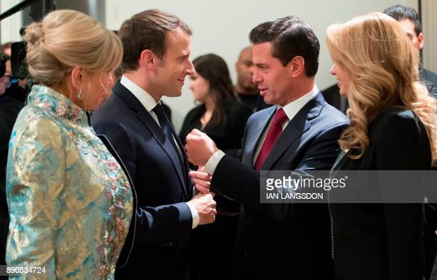 French President Emmanuel Macron and his wife Brigitte Macron speak with Mexican President Enrique Pena Nieto and his wife Angelica Rivera before a...