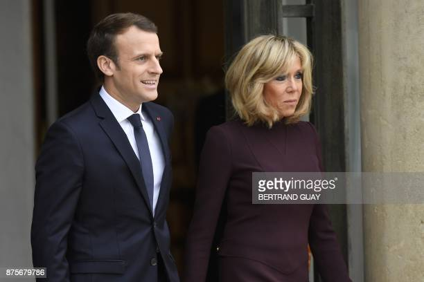 French President Emmanuel Macron and his wife Brigitte Macron stand prior to welcome Lebanese Prime Minister at the Elysee Presidential Palace on...