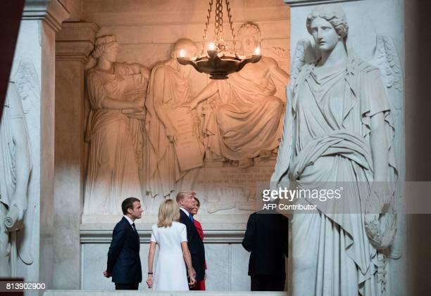 French President Emmanuel Macron and his wife Brigitte Macron US President Donald Trump and First lady Melania Trump visit Napoleon Bonapartes tomb...