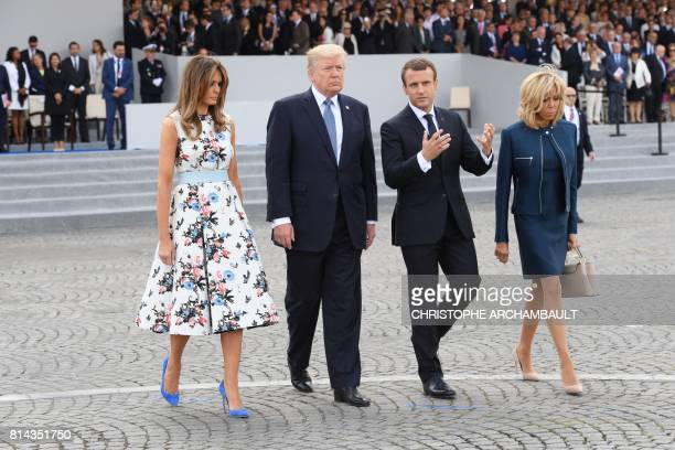French President Emmanuel Macron and his wife Brigitte Macron walk with US President Donald Trump and US First Lady Melania Trump after attending the...