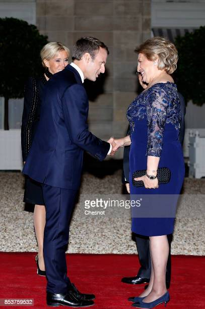 French President Emmanuel Macron and his wife Brigitte Macron welcome Lebanese President Michel Aoun and his wife Nadia Aoun prior to a state dinner...
