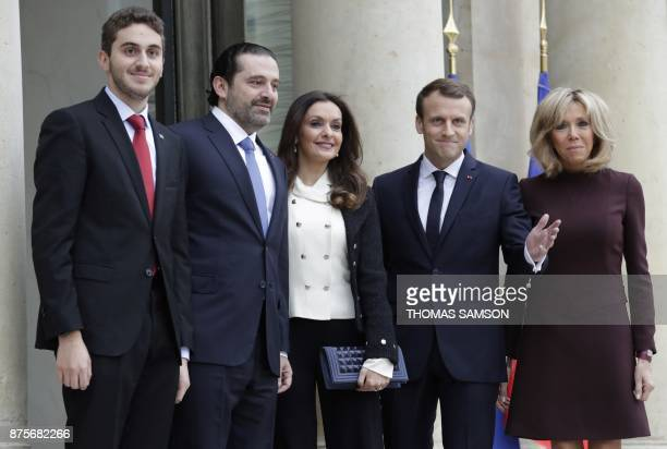 French President Emmanuel Macron and his wife Brigitte Macron welcome Lebanese Prime Minister Saad Hariri his wife Lara Bachir ElAlzm and their son...