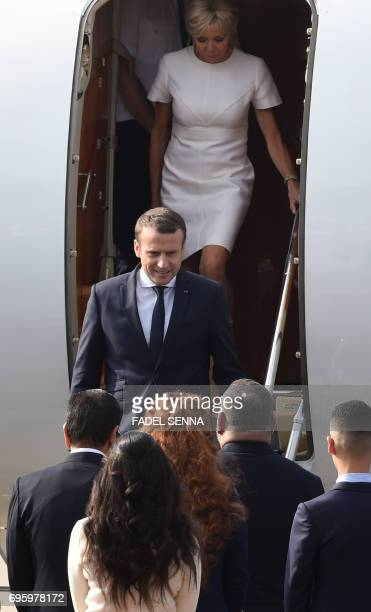 French President Emmanuel Macron and his wife Brigitte step out of an airplance after landing in Rabat on June 14 2017 Macron is on an official visit...