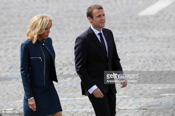 French President Emmanuel Macron and his wife Brigitte Trogneux during the traditional Bastille day military parade on the ChampsElysees on July 14...