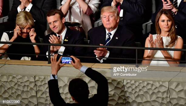 TOPSHOT French President Emmanuel Macron and his wife Brigitte Trogneux US President Donald Trump and US First Lady Melania Trump attend a concert at...