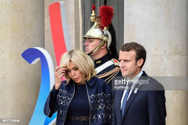 French President Emmanuel Macron and his wife Brigitte Trogneux wait to welcome their guests to celebrate Paris being announced as the host of the...