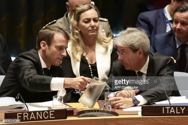 French President Emmanuel Macron and Italian Prime Minister Paolo Gentiloni speak as they participate in an open debate of the United Nations...