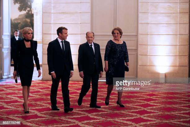 French President Emmanuel Macron and Lebanon's President General Michel Aoun arrive with Aoun's wife Nadia Al Chami and the French president's wife...