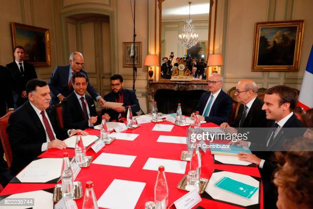 French President Emmanuel Macron and Libyan Prime Minister Fayez alSarraj attend a meeting for talks aimed at easing tensions in Libya in La...