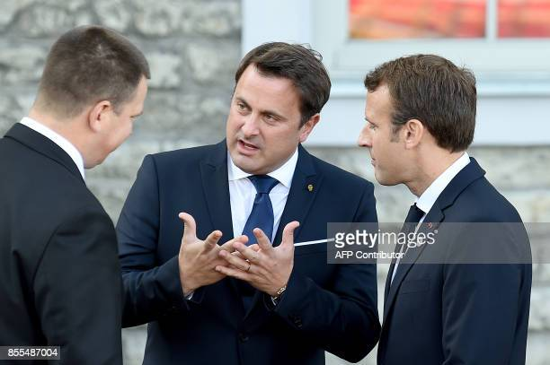 French President Emmanuel Macron and Luxembourg's Prime minister Xavier Bettel talk with Estonian Prime Minister Juri Ratas as they prepare to pose...