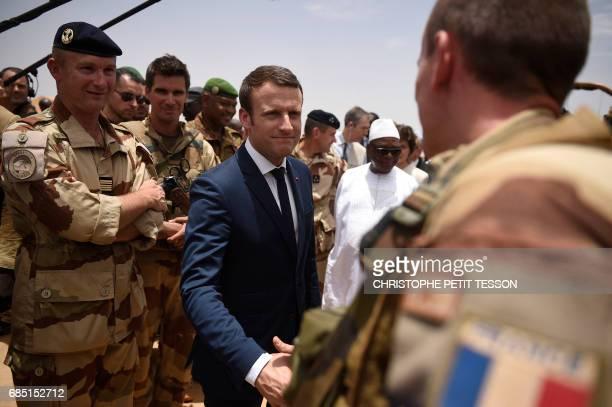 TOPSHOT French President Emmanuel Macron and Mali's President Ibrahim Boubacar Keita visit the troops of France's Barkhane counterterrorism operation...