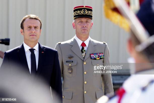 French President Emmanuel Macron and new French chief of military staff General Francois Lecointre review an honour guard at the BA 125 French Air...
