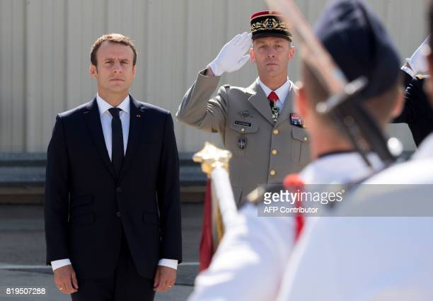 French President Emmanuel Macron and newly appointed French chief of military staff General Francois Lecointre review a military honour guard during...