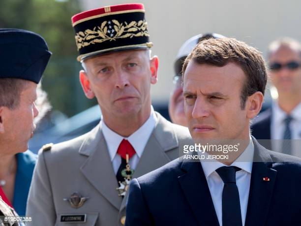 French President Emmanuel Macron and newly appointed French chief of military staff General Francois Lecointre speak with troops during a visit to...
