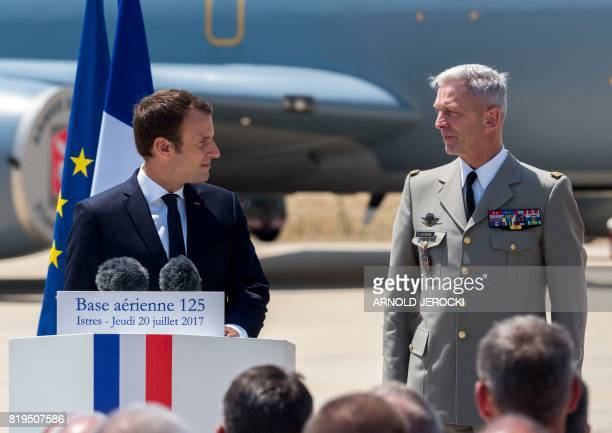 French President Emmanuel Macron and newly appointed French chief of military staff General Francois Lecointre deliver a speech during a visit to the...