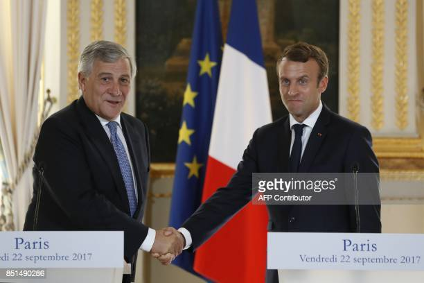 French President Emmanuel Macron and President of the European Parliament Antonio Tajani shake hands after delivering a press conference at the...