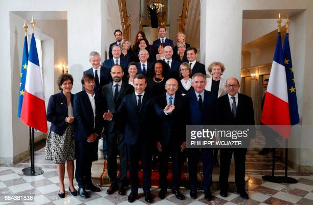 French President Emmanuel Macron and Prime Minister Edouard Philippe pose for a family photo after the first cabinet meeting at the Elysee Palace in...