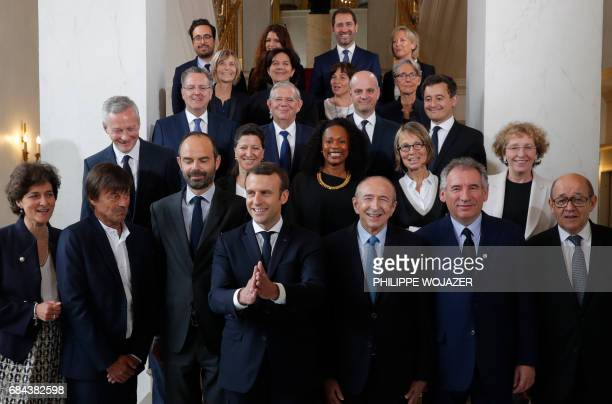 TOPSHOT French President Emmanuel Macron and Prime Minister Edouard Philippe pose for a family photo after the first cabinet meeting at the Elysee...
