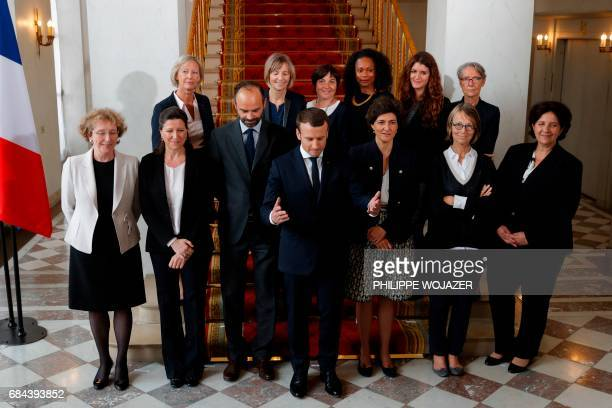 French President Emmanuel Macron and Prime Minister Edouard Philippe pose for a family photo with women of the government after the first cabinet...