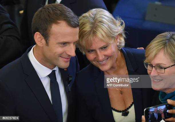French President Emmanuel Macron and rightwing Les Republicains party MP Nadine Morano pose for a picture during a ceremony for late German...