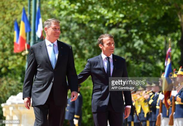 French President Emmanuel Macron and Romanian President Klaus Iohannis and review the guard of honour during the official ceremony at the Cotroceni...