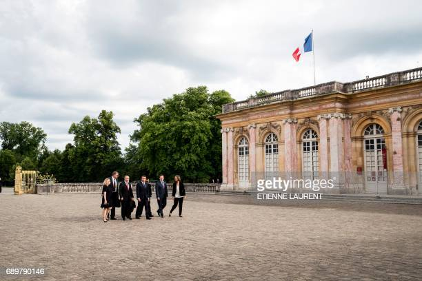 French President Emmanuel Macron and Russian President Vladimir Putin arrive to visit an exhibition about Russian emperor Peter the Great at the...