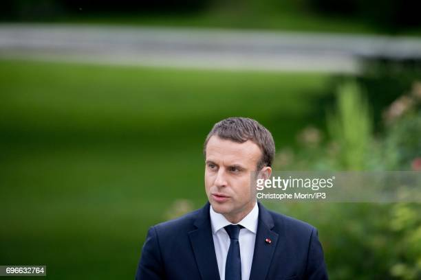 French President Emmanuel Macron and UK Prime Minister Theresa May deliver a speech during a press conference after their meeting and before to...