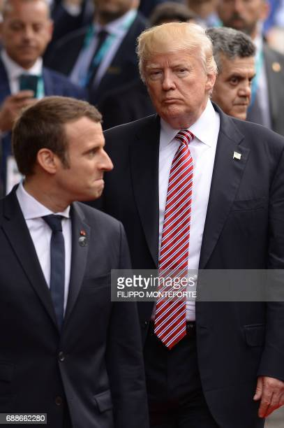 French President Emmanuel Macron and US President Donald Trump arrive at the Hotel San Domenico during the Summit of the Heads of State and of...