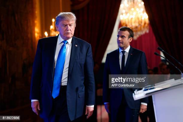French President Emmanuel Macron and US President Donald Trump arrive to hold a press conference following meetings at the Elysee Palace in Paris on...