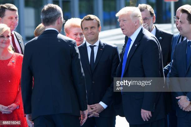 French President Emmanuel Macron and US President Donald Trump attend the unveiling ceremony of the new NATO headquarters in Brussels on May 25...
