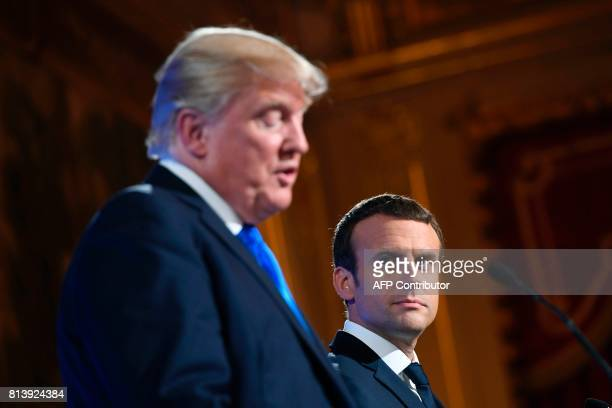 French President Emmanuel Macron and US President Donald Trump hold a press conference following meetings at the Elysee Palace in Paris on July 13...