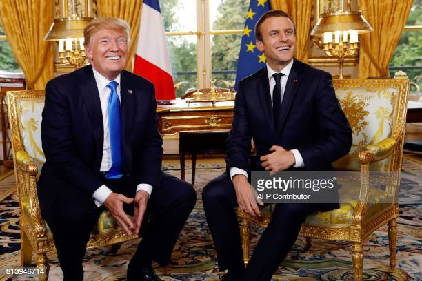French President Emmanuel Macron and US President Donald Trump pose during their meeting at the Elysee Palace in Paris on July 13 2017 / AFP PHOTO /...